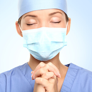 Praying Nurse