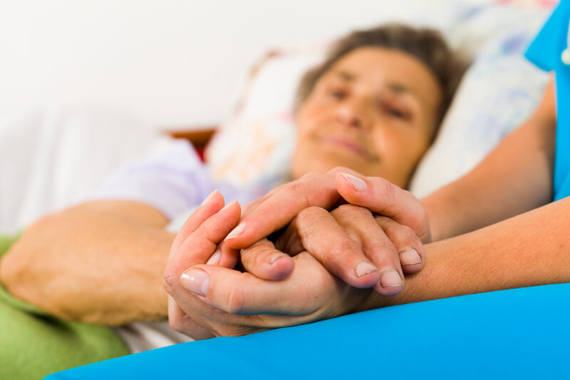 Nursing Holding Patients Hand
